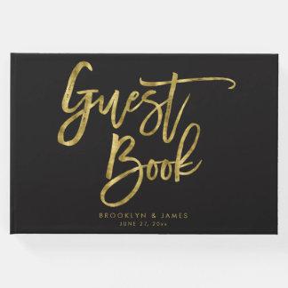 Noir et livre d'invité de mariage d'or