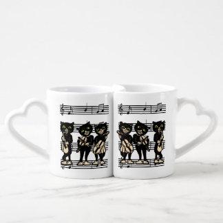 Notes vintages de musique de chats noirs de mug