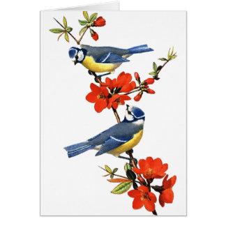 Oiseaux bleus avec la carte de voeux de fleurs