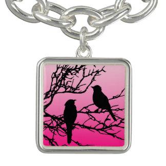 Oiseaux sur une branche, noire contre le rose bracelets