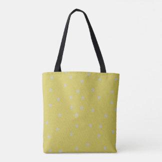 Or avec le sac modelé par étoiles d'argent
