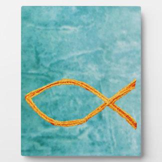 Or chrétien de poissons sur le bleu/vert photos sur plaques