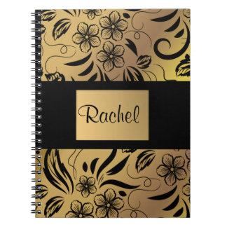 Or et carnet modelé floral de noir tout nom