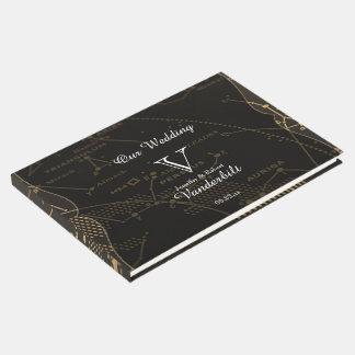 Or et livre d'invité noir de mariage de
