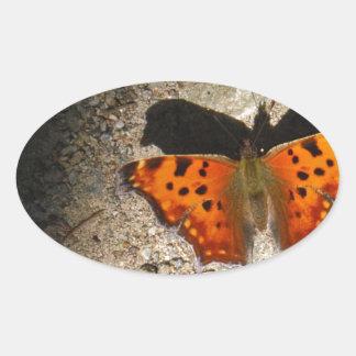 Oranje en groene vlinder ovale sticker