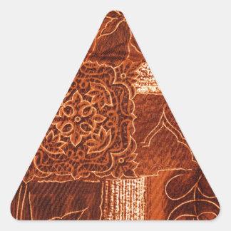 oranje lapwerkstof driehoek sticker
