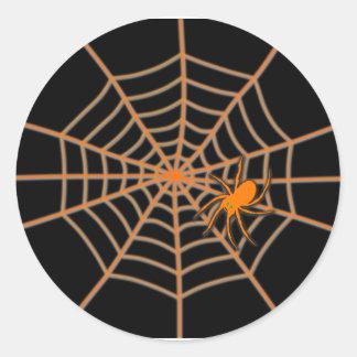 Oranje spin en Web op zwarte Ronde Sticker