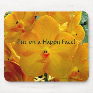 Orchidées heureuses de jaune de visage tapis de souris