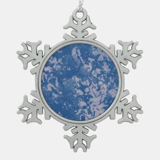 Ornement bleu de flocon de neige d'étain de neige