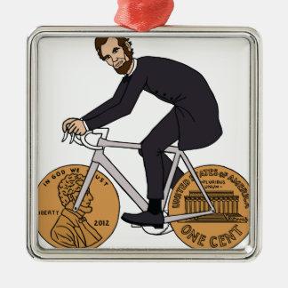Ornement Carré Argenté Abraham Lincoln sur un vélo avec le penny roule la
