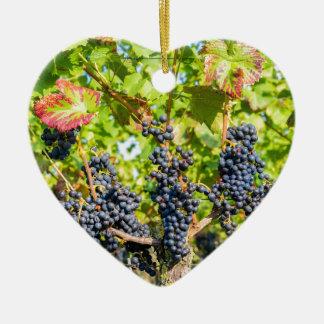 Ornement Cœur En Céramique Groupes bleus accrochants de raisin dans le