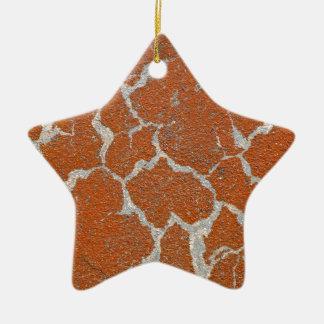 Ornement Étoile En Céramique Vieille couleur rousse sur le béton