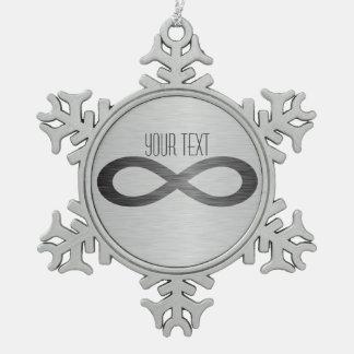 Ornement Flocon De Neige Symbole d'infini sur la texture en métal de Faux