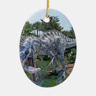 Ornement Ovale En Céramique Dinosaure de Suchomimus mangeant un requin dans un