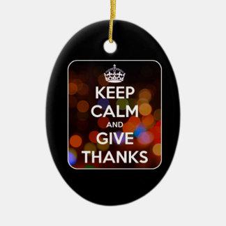 Ornement Ovale En Céramique Gardez le calme et donnez à des mercis Bokeh noir