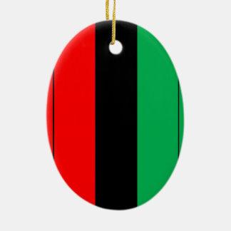 Ornement Ovale En Céramique Kwanzaa colore le motif vert noir rouge de rayures