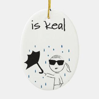 Ornement Ovale En Céramique La lutte d'échouer de parapluie est vraie