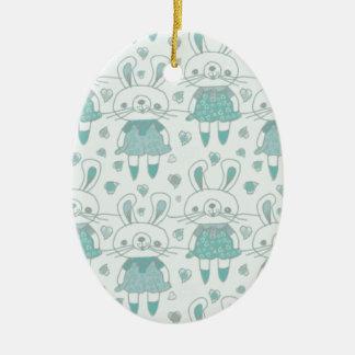 Ornement Ovale En Céramique Lapins heureux dans le bleu