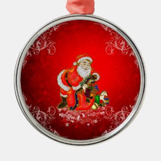 Ornement Rond Argenté Noël, le père noël avec des cadeaux