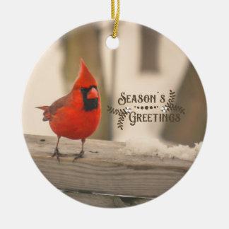 Ornement Rond En Céramique Beau cardinal de vacances dans la neige