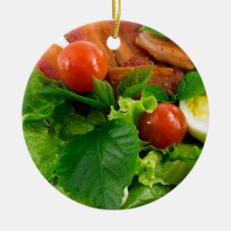 Ornement Rond En Céramique Tomates cerise, herbes, huile d'olive, oeufs et