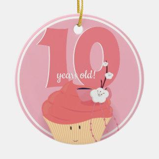 Ornement rose de l'anniversaire   de petit gâteau