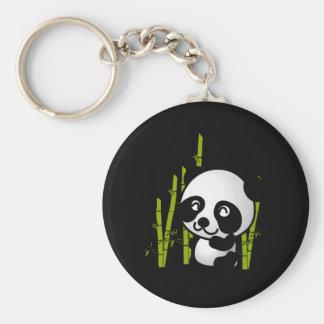Ours panda noir et blanc mignon dans un verger en porte-clé rond