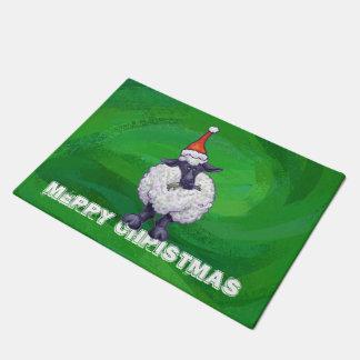 Paillasson Moutons mignons dans le casquette de Père Noël sur
