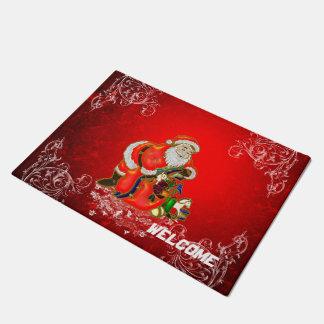 Paillasson Noël, le père noël avec des cadeaux sur le