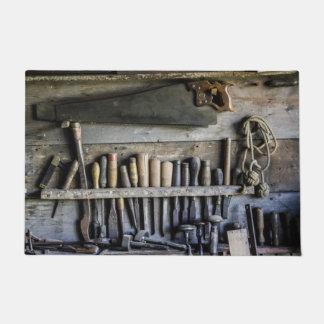 Paillasson outils en bois vintages de porte d'antiquité