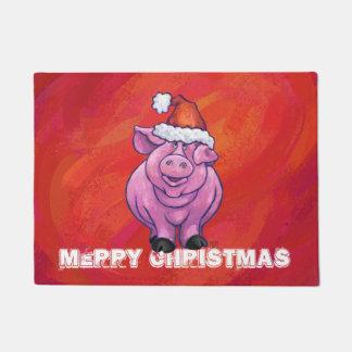 Paillasson Porc mignon dans le casquette de Père Noël sur le