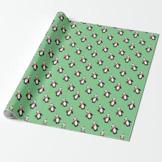 Papier Cadeau Pingouins de Noël sur vert clair