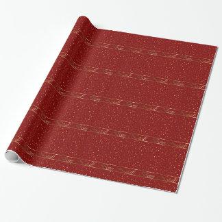 Papier d'emballage d'étoiles d'or rouges natales papier cadeau