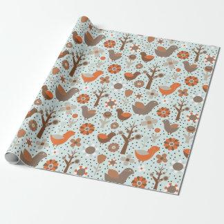 Papier d'emballage d'oiseaux de motif orange et papier cadeau noël