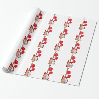 Papier rouge et blanc de guitare et de cadeau de papier cadeau noël