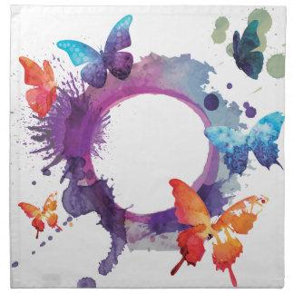 Papillons en pastel d'aquarelle autour d'un anneau serviettes en tissus