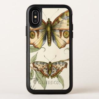 Papillons tandem au-dessus de feuille vert
