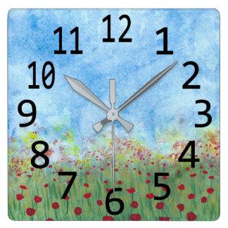 Pavots rouges dans des horloges de peinture