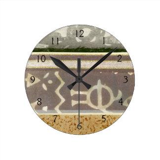 motif africain horloges motif africain pendules murales. Black Bedroom Furniture Sets. Home Design Ideas