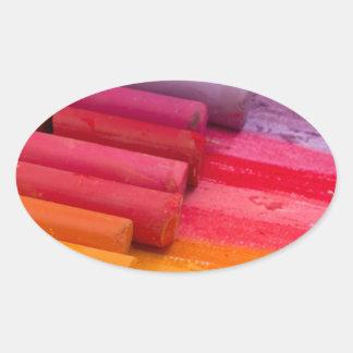 pensez en couleurs sticker ovale