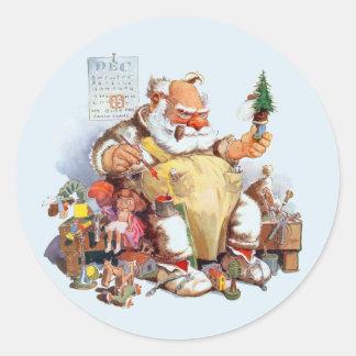 Père Noël faisant des autocollants de jouets