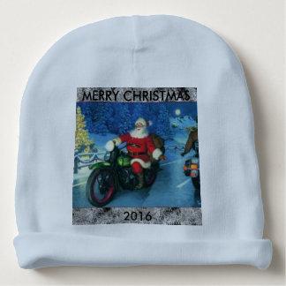Père Noël montant un casquette de bébé de calotte Bonnet Pour Bébé