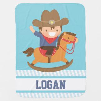 Petit cowboy mignon sur des bébés de cheval de couvertures pour bébé