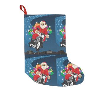 Petite Chaussette De Noël Père Noël volant dedans sur sa moto
