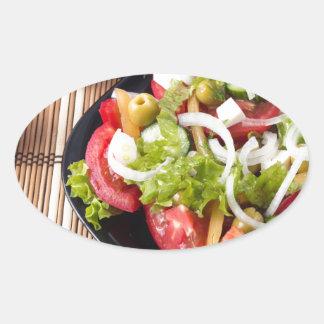 Petite partie de salade végétale de tomate sticker ovale