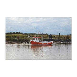 Petite toile orange de bateau de pêche