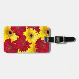Photographie rouge et jaune de marguerite de étiquette à bagage