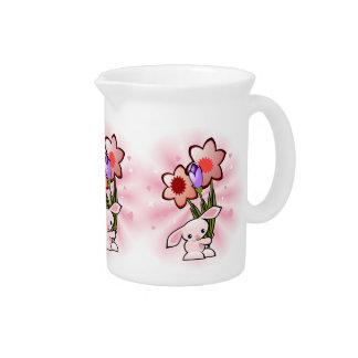Pichet Lapin rose mignon avec des fleurs Pâques