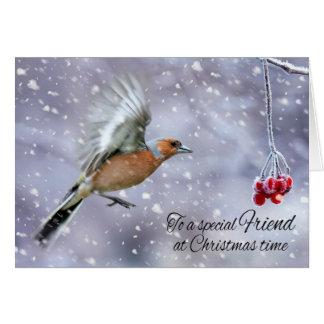 Pinson d'ami dans la salutation de neige d'hiver carte de vœux