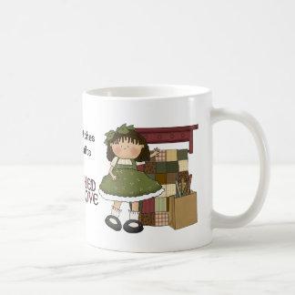 Piqué avec la tasse de café piquante d'amour
